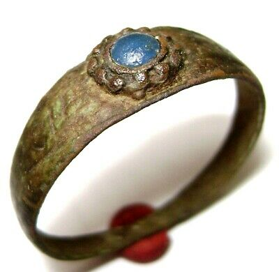 Ancient Medieval bronze finger ring with blue stone.
