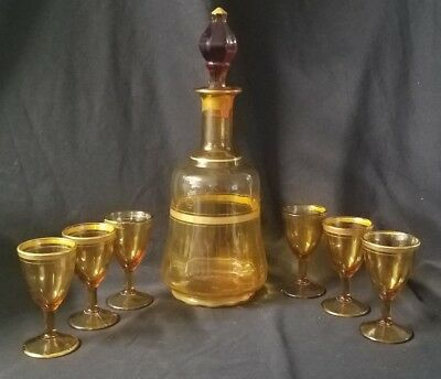 Vintage amber glass decanter with 6 stemmed glasses, gold accented liquor