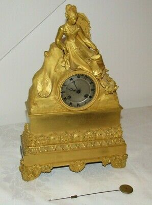 A Finely Bronze Cast & Early French Silk Ormolu Striking Clock