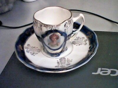 Small two faced ladies mini German tea cup and saucer Dainty classic porcelain!