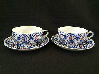 Antique Chinese Tea Cup and Saucer. Saucers are marked with several marks