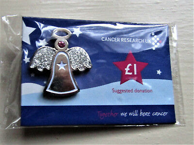 Cancer Research UK Pin Badge snowflakes vary Snowflake with Red Stone