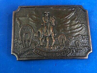 Vintage TALL IN THE SADDLE belt buckle - cowboy on horse  with covered wagons