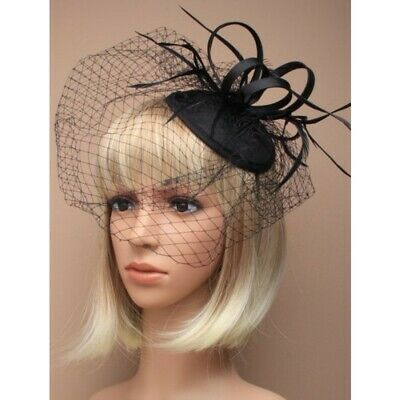 Black Fascinator with skull cap comb and elastic to hold , weddings, races