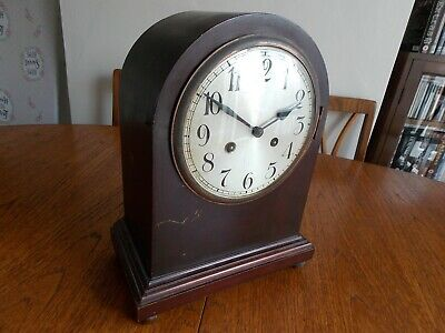 Vintage large striking Junghans mantel clock,working but sold for restoration.
