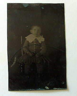Vintage Antique Tintype Young Child In Chair Long Stockings Unique Costume Dress