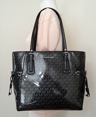 f1332fed49e6 MICHAEL KORS VOYAGER East West Signature Glossy Tote in Black Silver ...