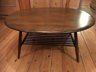 Ercol blue label dark oval coffee/supper table with magazine rack