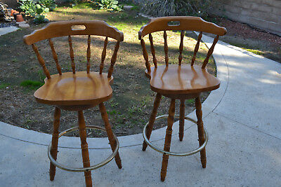 "Set of two vintage 29"" swiveling bar stools - probably maple."