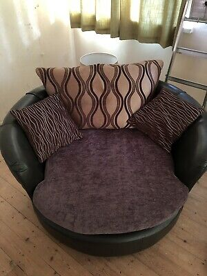dfs Spinning cuddle chair Sofa with Matching Footstool