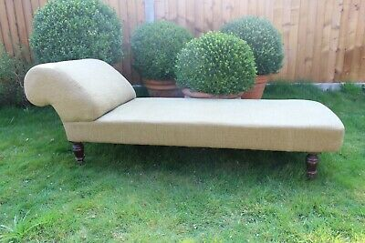 Antique Green upholstered chaise lounge, wooden feet with original casters