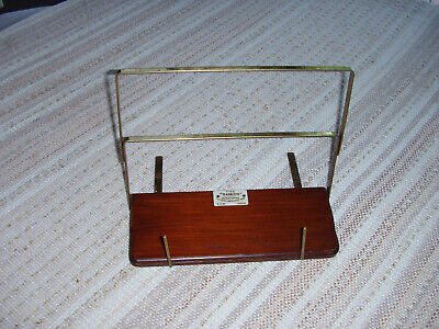 Antique book rest made from polished wood and brass Folds flat.