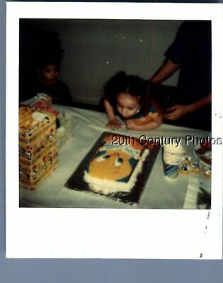 Found Color Polaroid P+2858 Girl Leaned Over Tgable By Tweety Bird Cake