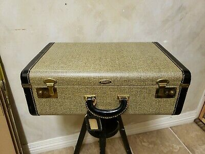 Vintage Indestructo Suitcase covered in Embossed Leather, Fabric Lined Inside