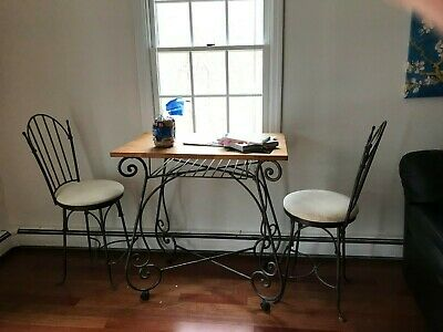 Charleston Forge Shaker Arched Swivel Bar Stools and wood table with wine rack