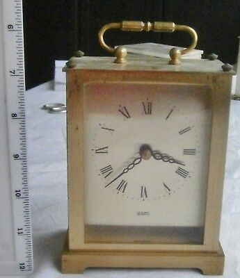Large German quartz carriage  clock in brass from 70's
