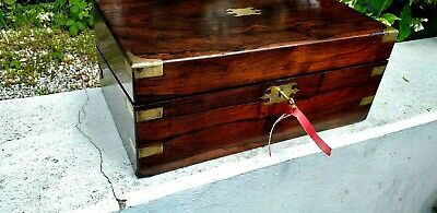 A lovely rosewood &brass writing  slope  with  a Working lock &key 2 inkwells