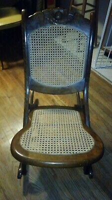Vintage Foldable Wooden Rocking Chair. Very solid. Upholstery has been updated.