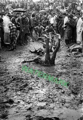 Sliding in the mud pits at the original Woodstock in 1969. PUBLICITY PHOTO