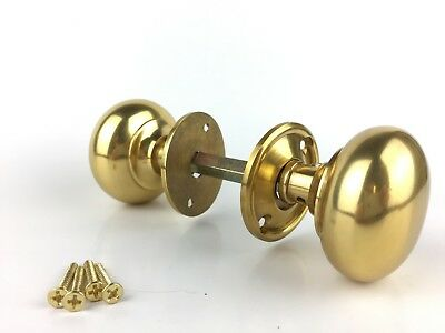 A pair of classic Victorian brass door knobs mushroom internal door handle