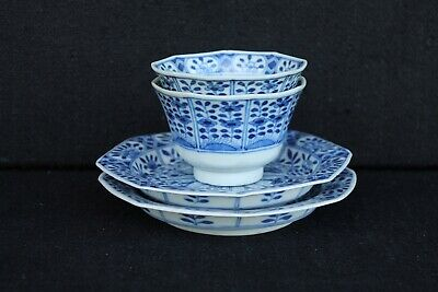 Two 19th century Chinese tea bowls and saucers marked Kangxi