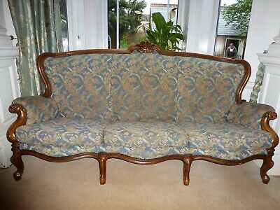 French Louis XV blue floral sofa with carved detailed wood work, chateau