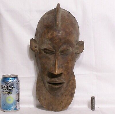 Very old carved wooden African mask with beard