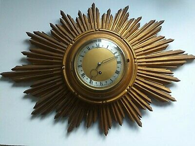 Vintage Original Starburst 8day Wall Clock fully working wooden rays.