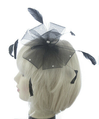 Black mesh feather fascinator with crystals on a comb weddings, races,