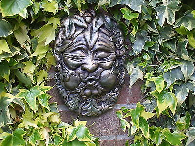 Bronzed Medieval Green Leaf Blowing Man  Stone Head Wall Plaque