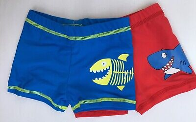 Baby Boys 2 pack Swim Trunks. 1 x Red with Shark + 1 x Blue with Shark 9-12 moth