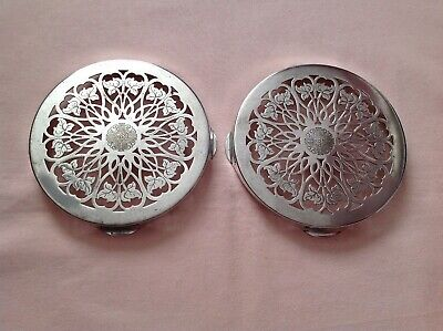 ANTIQUE VINTAGE ART DECO PAIR OF EPNS POT/ BOTTLE EMBOSSED STANDS GOOD USED.t