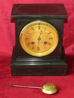 A Delightful Small French Black Marble Mantle Clock With Brass Dial