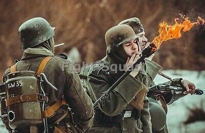 WW2 Picture Photo german soldier lighting cigarette with flamethrower 3321