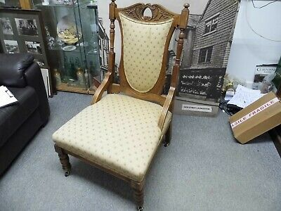 Antique Victorian Nursing / Fire Side chair with carved decoration brass castors