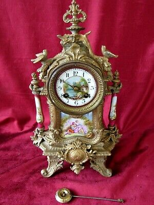 A Delightful French Gilt Mantle Clock With Painted Panels