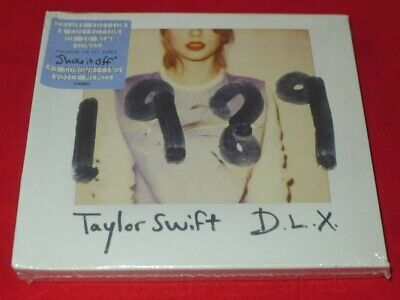 1989  by Taylor Swift  16 Track song+3 Voice Memos + polaroids (D.L.X.)