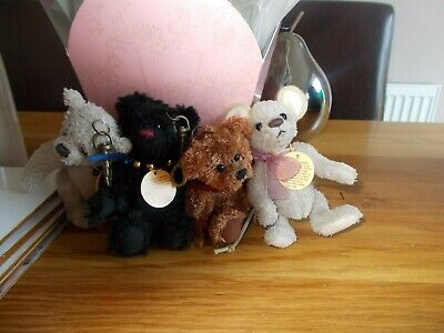 charlie bear set of four bag buddies  all have tags on