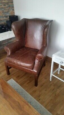 High Back Wing Back Armchair in Distressed Dark Brown Leather- Good Condition
