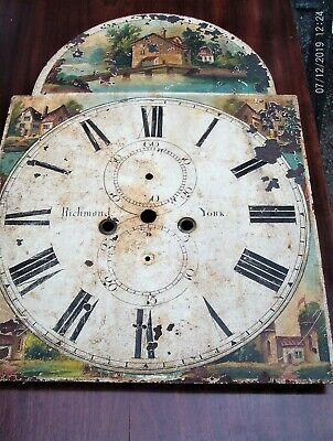 Antique metal grand farther clock face
