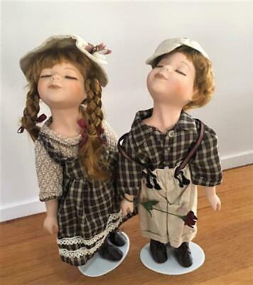 PAIR of VINTAGE BOY AND GIRL 33cm PORCELAIN KISSING DOLLS WITH STANDS / VGC