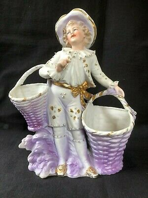 Antique Bisque / porcelain figurine with flowerbaskets. Marked back