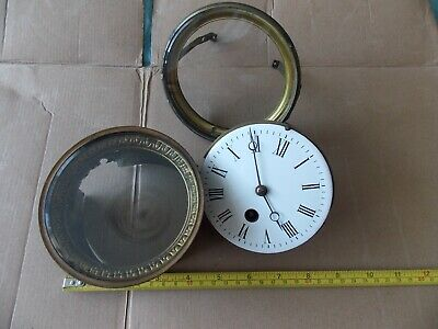 Vintage French clock movement and bezels for restoration.