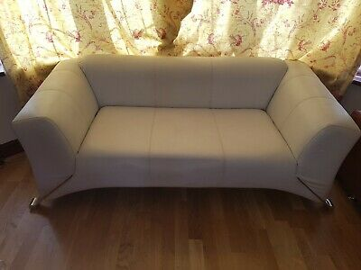 Lovely white 2 Seat Faux Leather Sofa. Copy of a rolf benz design.