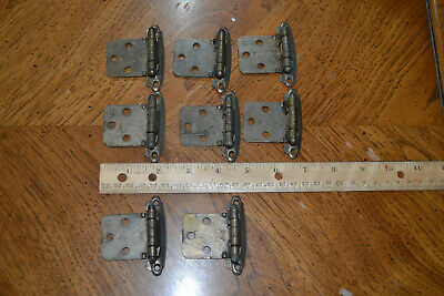 Set of 8 antique brass spring loaded cabinet hinges.