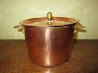A small Victorian tin lined copper cooking pot and lid