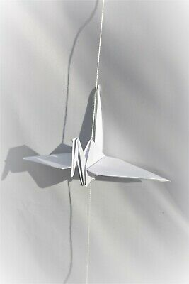 White Origami Crane on White Thread. Symbolising Heath, Long Life, Happiness and