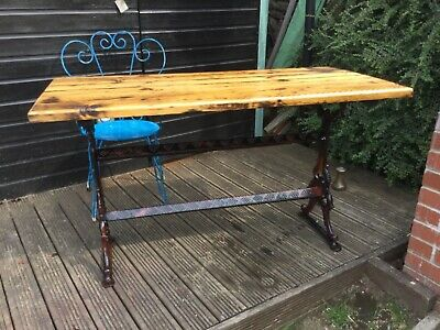 Solid wrought iron table  with solid pine top