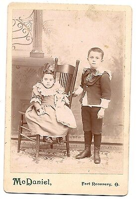 Cabinet card of young children, boy and girl (holding doll),  Fort Recovery, OH.
