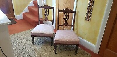 Pair of Victorian Mahogany Carved Fireside / Nursing Chairs With Castors.
